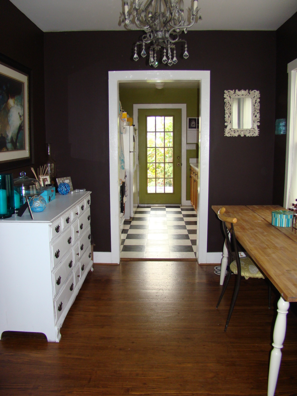 This was our tiny shotgun dining room. I painted it a dark brown and LOVE it. It was like having velvet on the walls. I also repainted a vintage dresser I found and used it as a buffet.