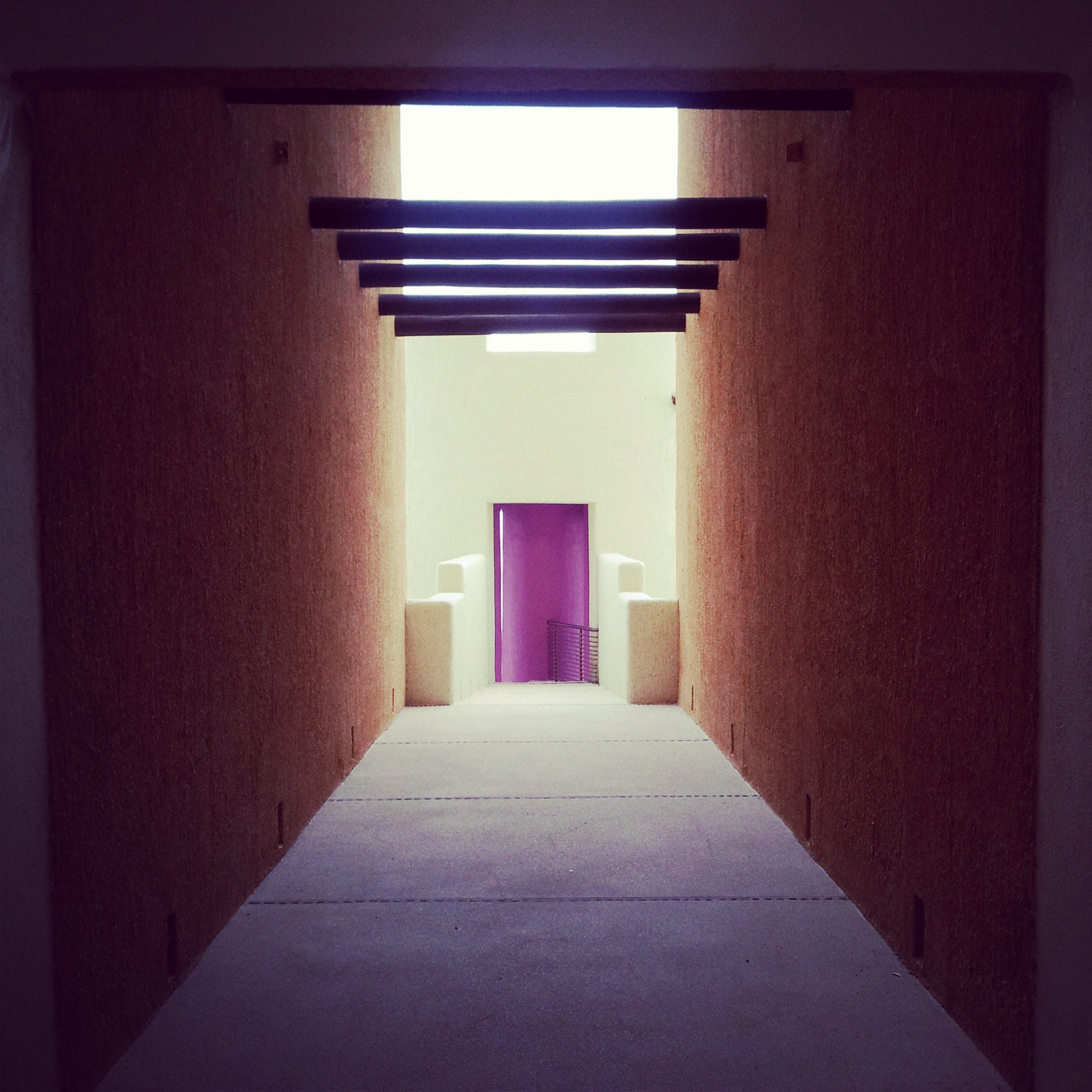 Hallway to the magenta stairwell.