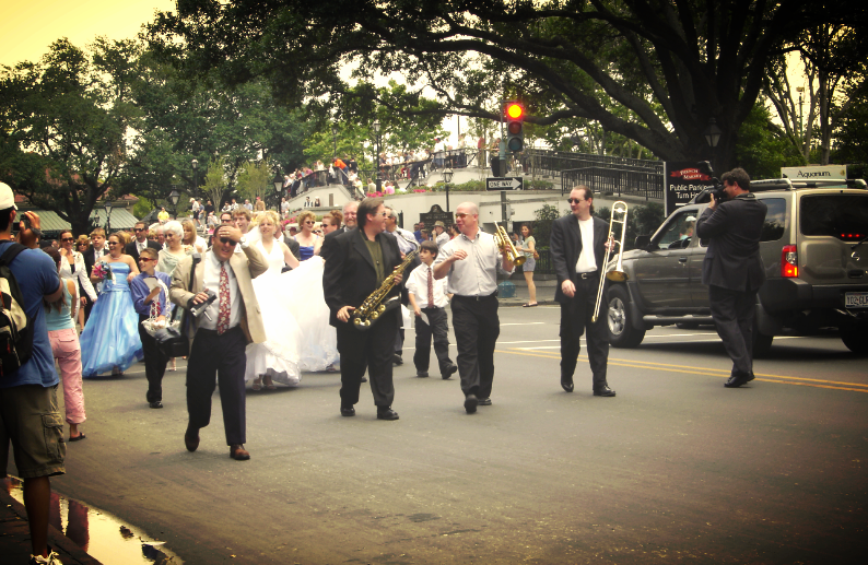 or stumble upon a traditional second line wedding parade.