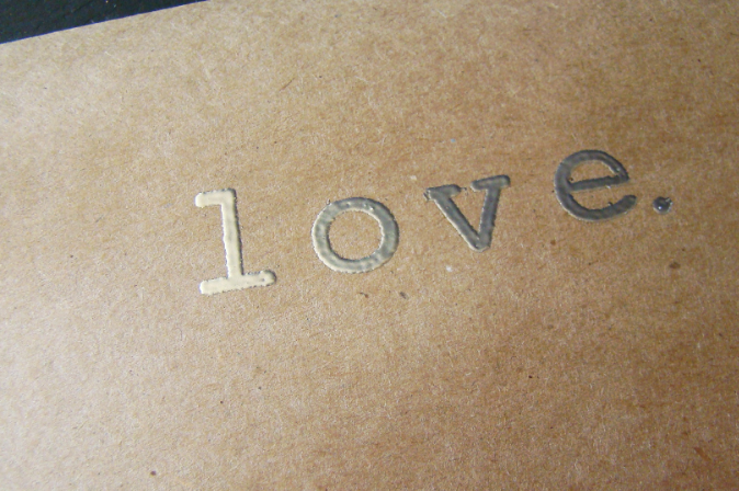Here is a close up of a fully embossed image. The metallic reads clearer on camera than the red powder.