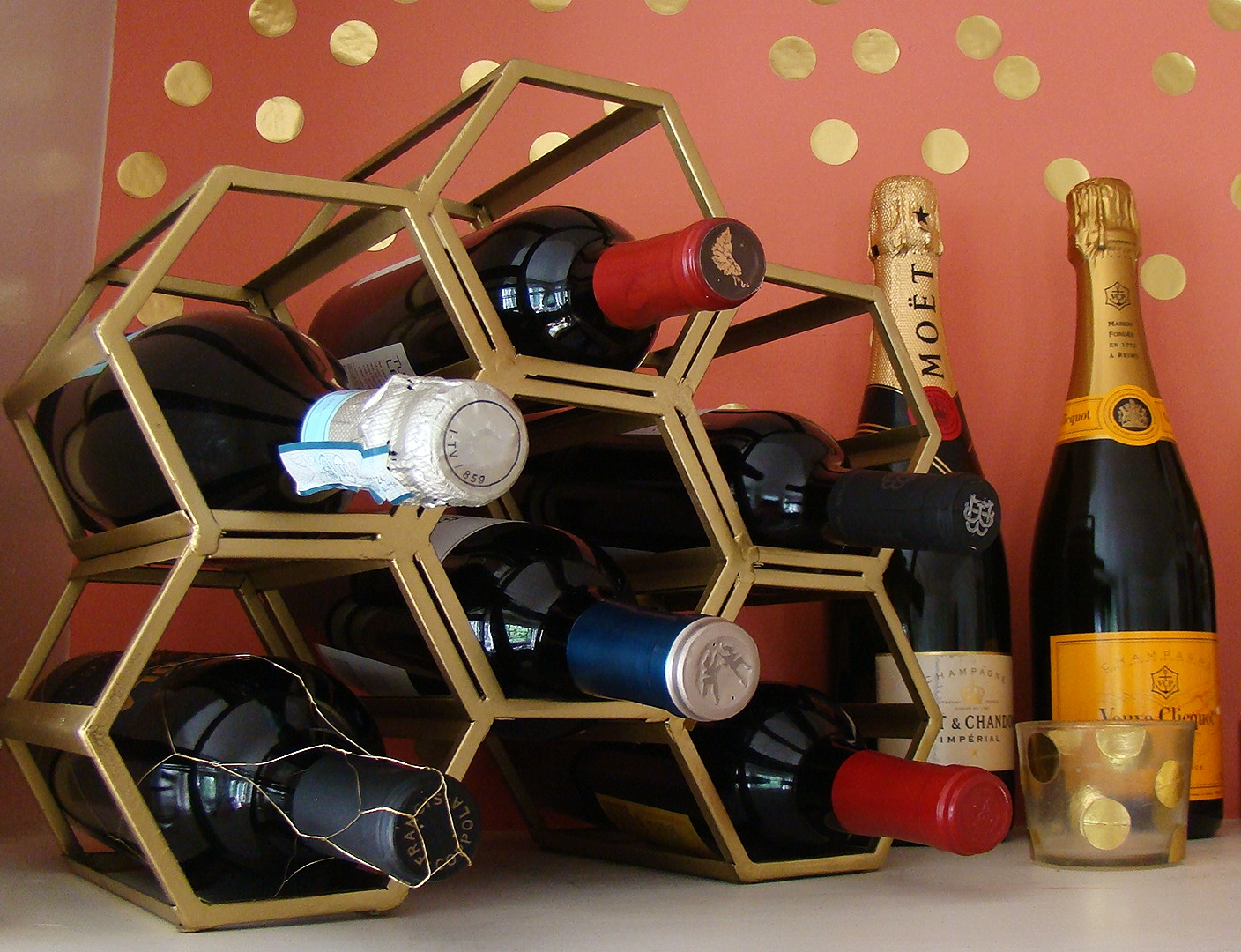This neat architectural wine rack used to be black iron. Now look how glamorous it looks!