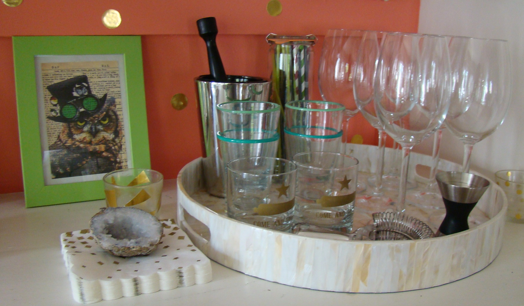 Get all your entertaining glasses and barware in one space, That way everything is within reach when folks want a drink.
