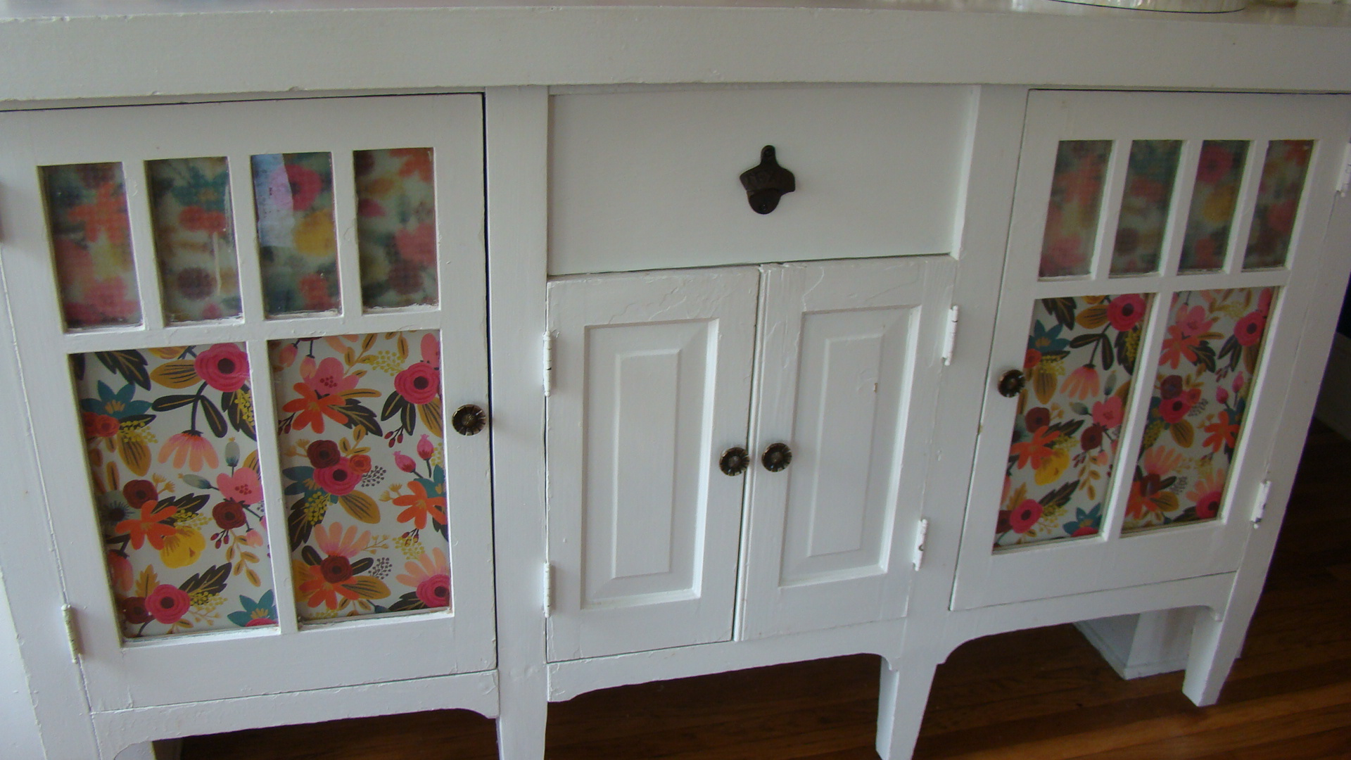 Ta-da! I just taped these pretty pieces of paper on the backside of their glass front cabinets. A super easy fix!