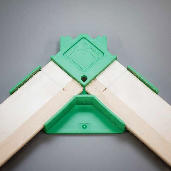 Reusable patented clamps ensure perfectly square frames while keeping the adhesive tape from touching the canvas.