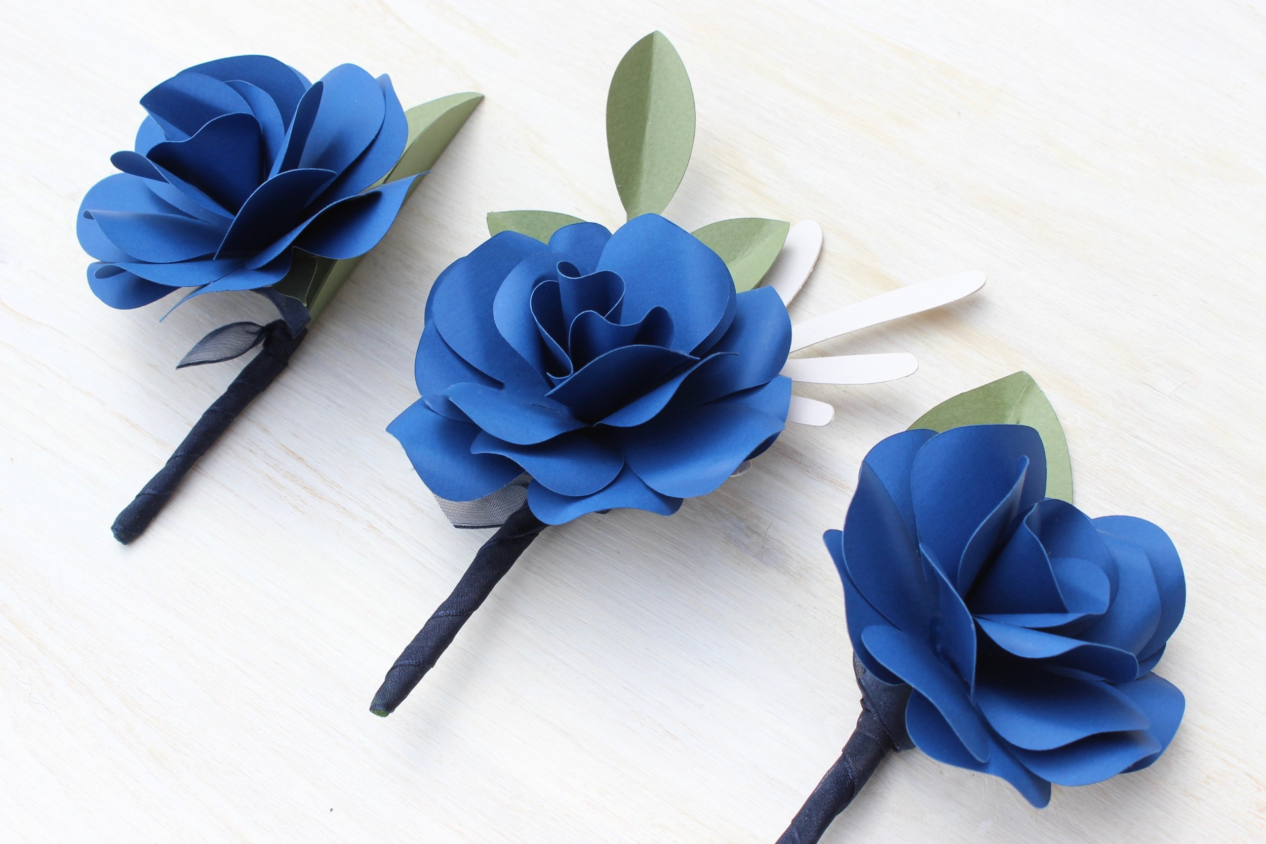 Royal blue paper rose buttonhole