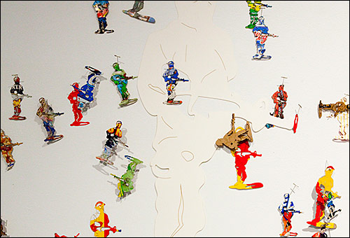 Cut out images of toy army men made from used cereal and snack boxes with high sugar content.