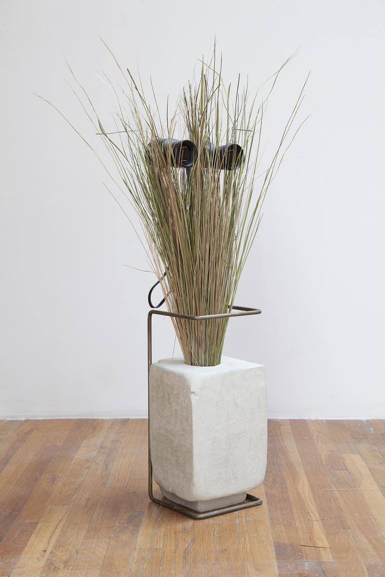 Face Off (Bird Watcher) 2013 Binoculars, grass, concrete and steel Dimensions variabl
