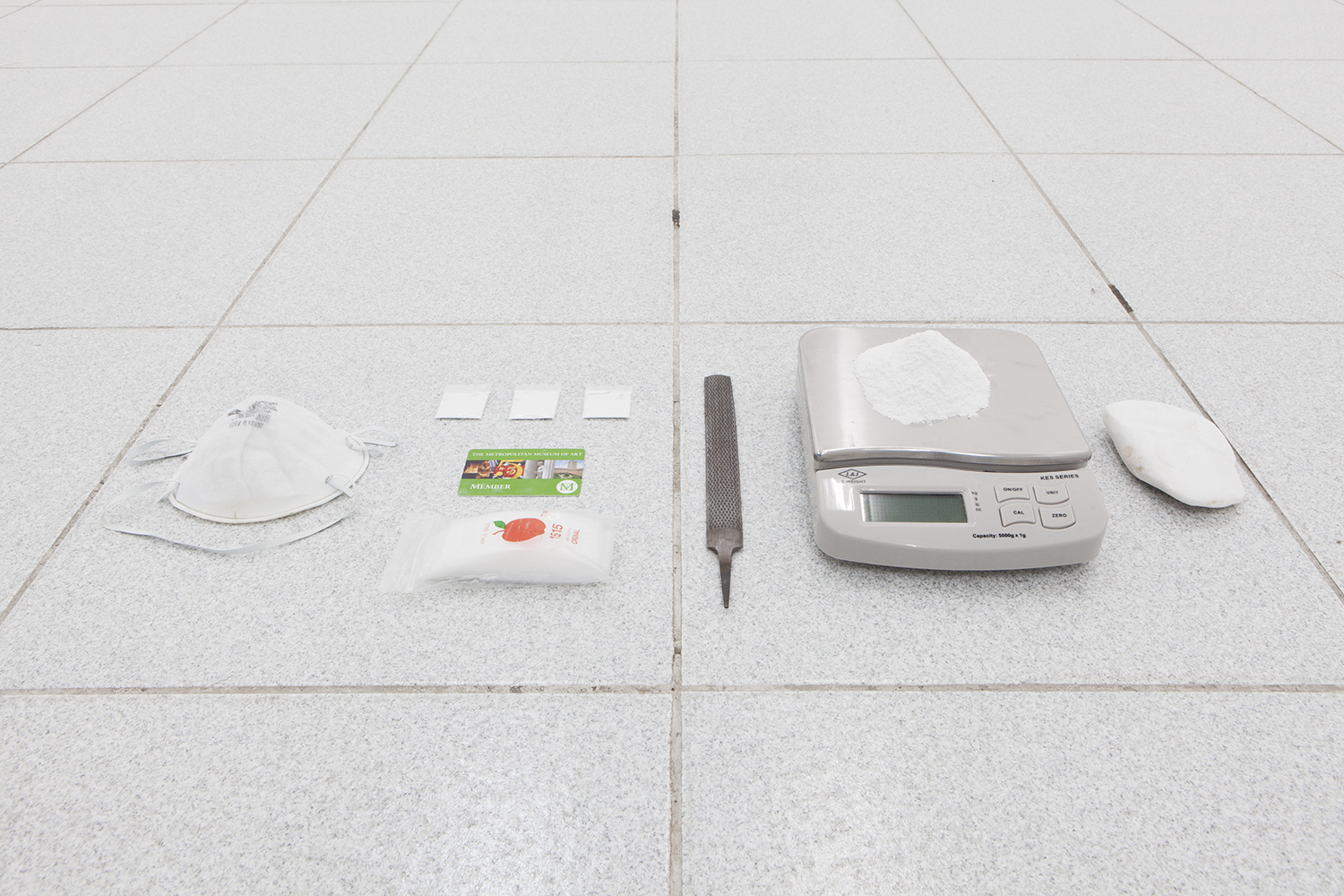 Isaac Brest  This Shit Right Here N****?! , 2014 Plastic baggies, dust mask, salvaged marble from parthenon, metal file, salvaged marble from Parthenon filed down to powder, four plastic baggies containing one gram of Parthenon powder and Metropolitan Museum membership card Dimension variable