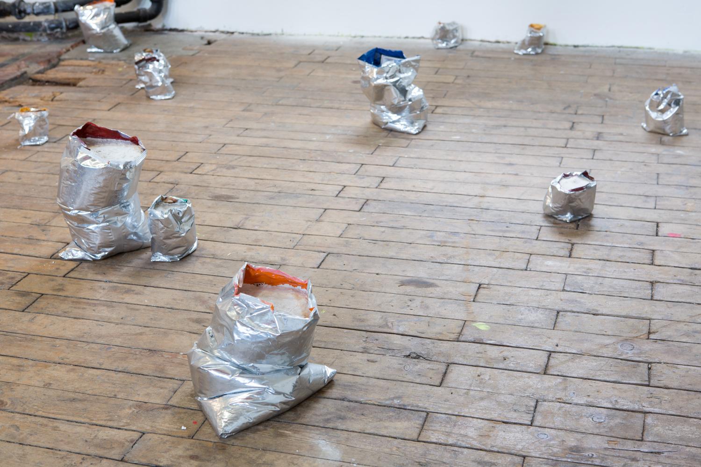 Brendan Lynch  20 Crisp Packets , 2014 Concrete, chip bags Variable