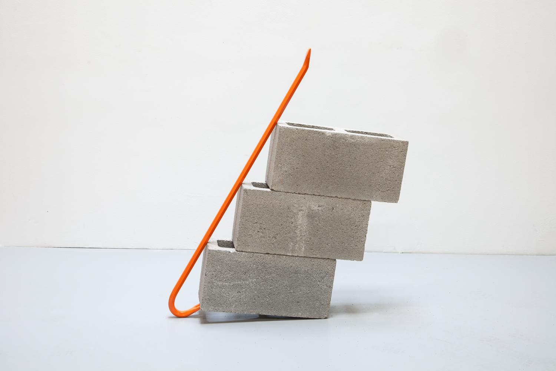 Standing Alone with Three Cinderblocks (orange) ,2013 Steel crowbar and cinderblocks 27 x 5 1/2 x 34 1/2 inches