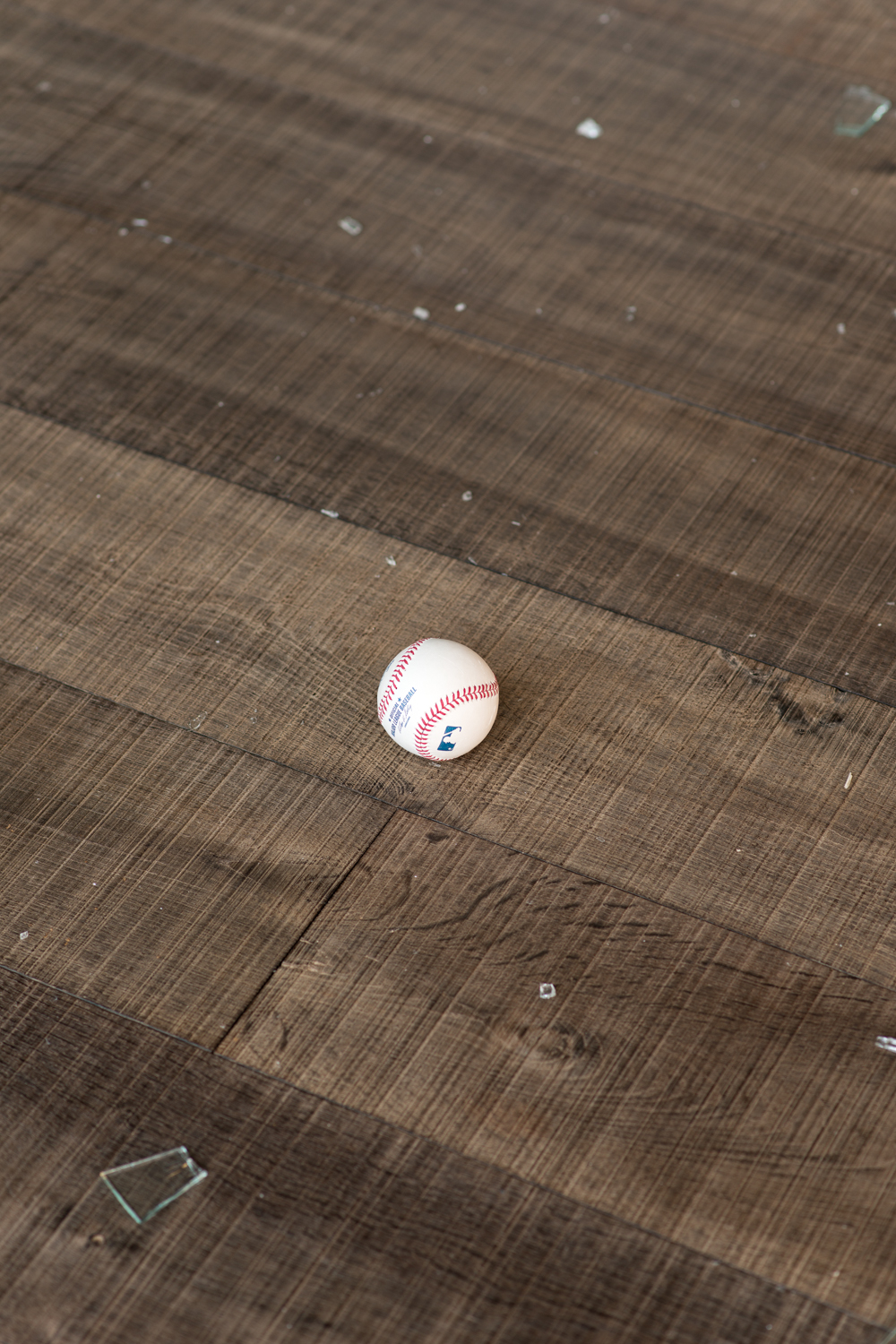 Forced Collaboration  (detail),2014 Baseball thrown through gallery window  Dimensions variable