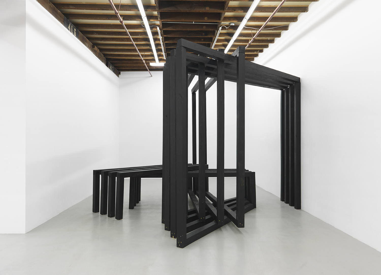 Four Vault,  2015 Pressure treated timber, chalk paint, and fragments used in live event 104 x 164 x 164 inches