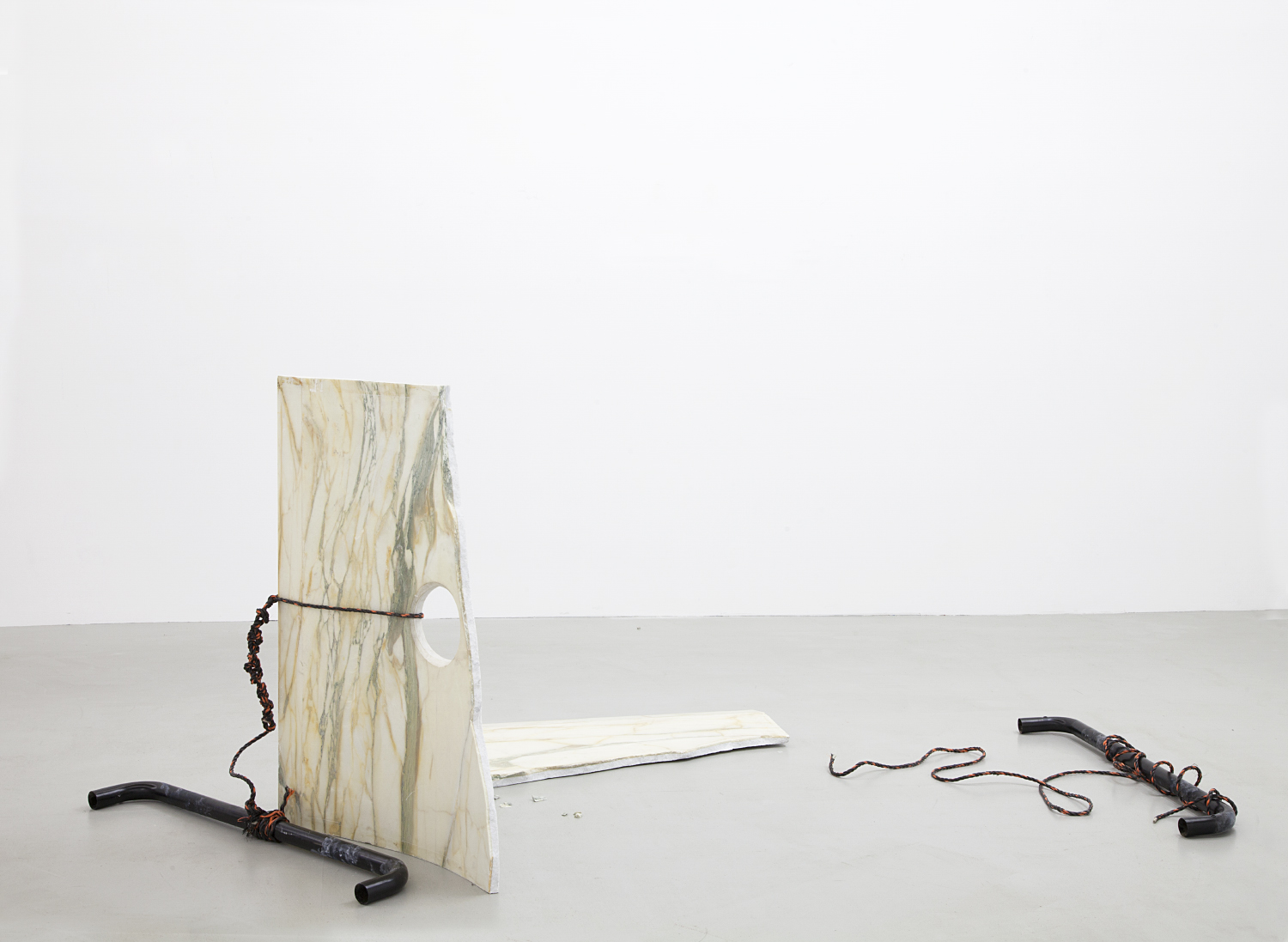 Limen Locale , 2015 Fragment from live event. Marble, rope, and coated aluminum bars 42.5 x 104.5 x 60 inches