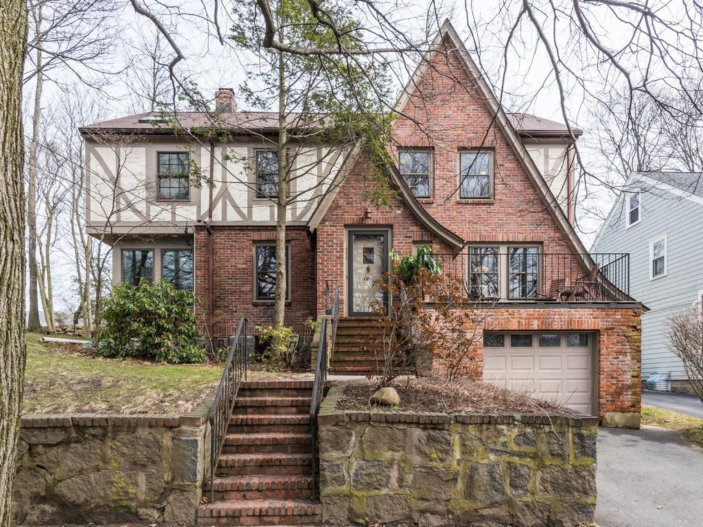 Updated 3-bedroom brick tudor with two offices, a TV room, and a sun room gives you plenty of space to spread out.