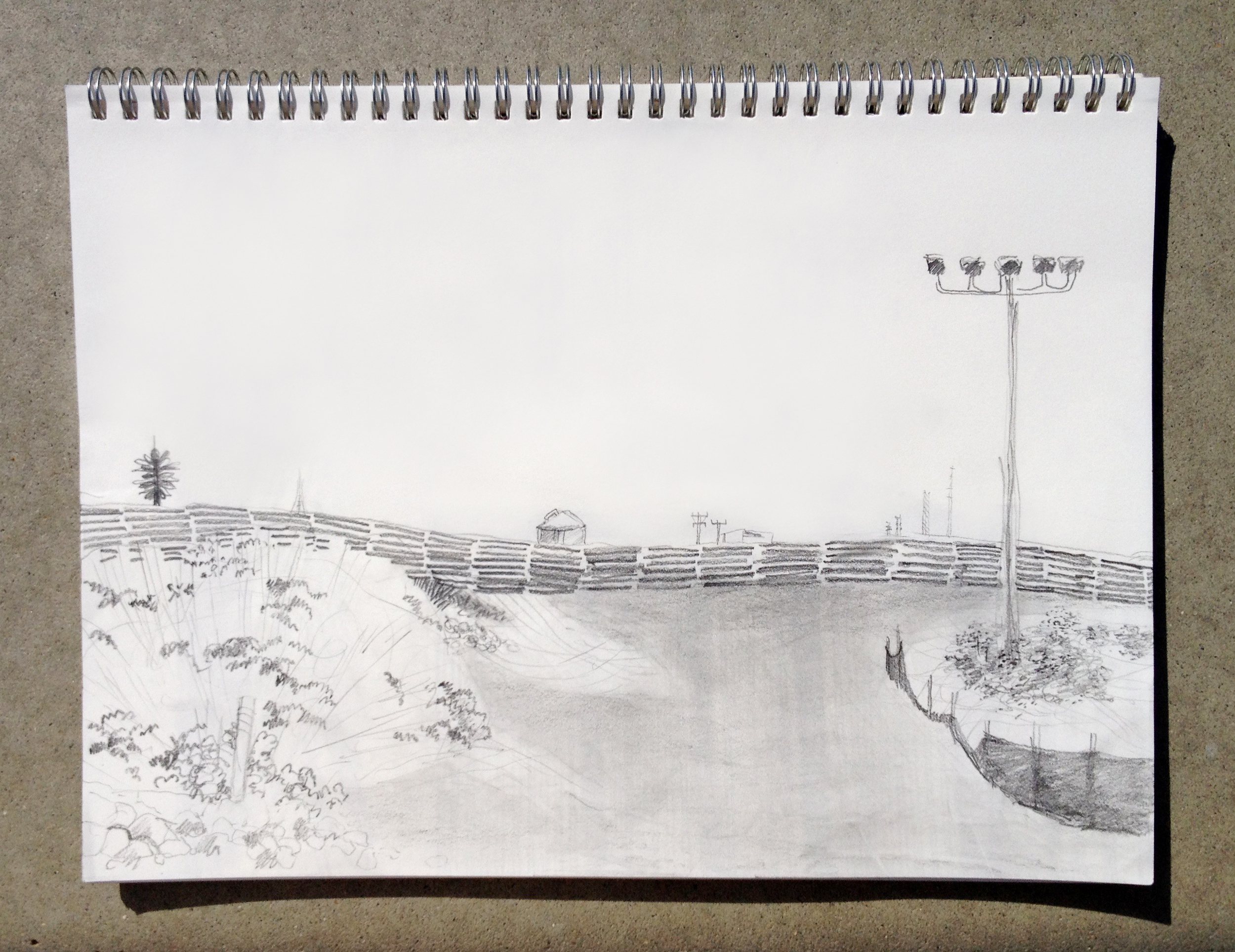 View of the southern border wall | Drawing by Jena Lee