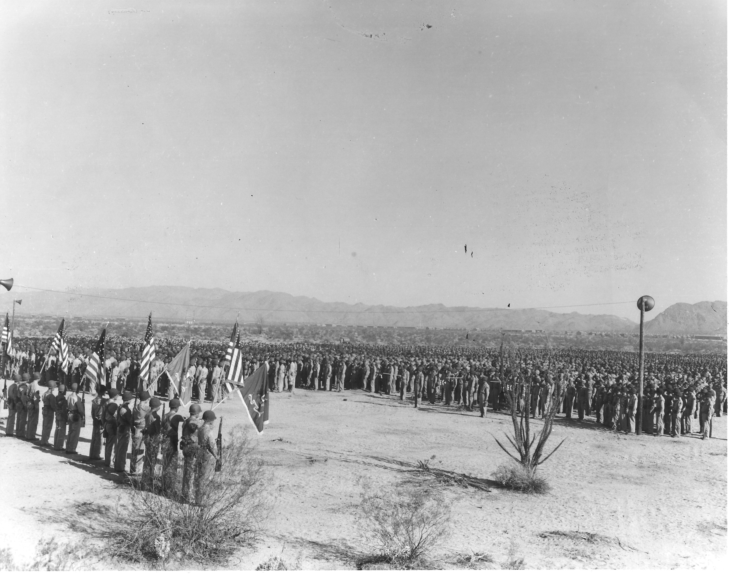 Here soldiers, and likely local press and dignitaries, listen to an address by Patton at the Desert Training Center. Patton's larger than life personality and premature death contributed to both locals and troops' emphasis on the general in DTC memorial attempts. Courtesy of the General Patton Memorial Museum.