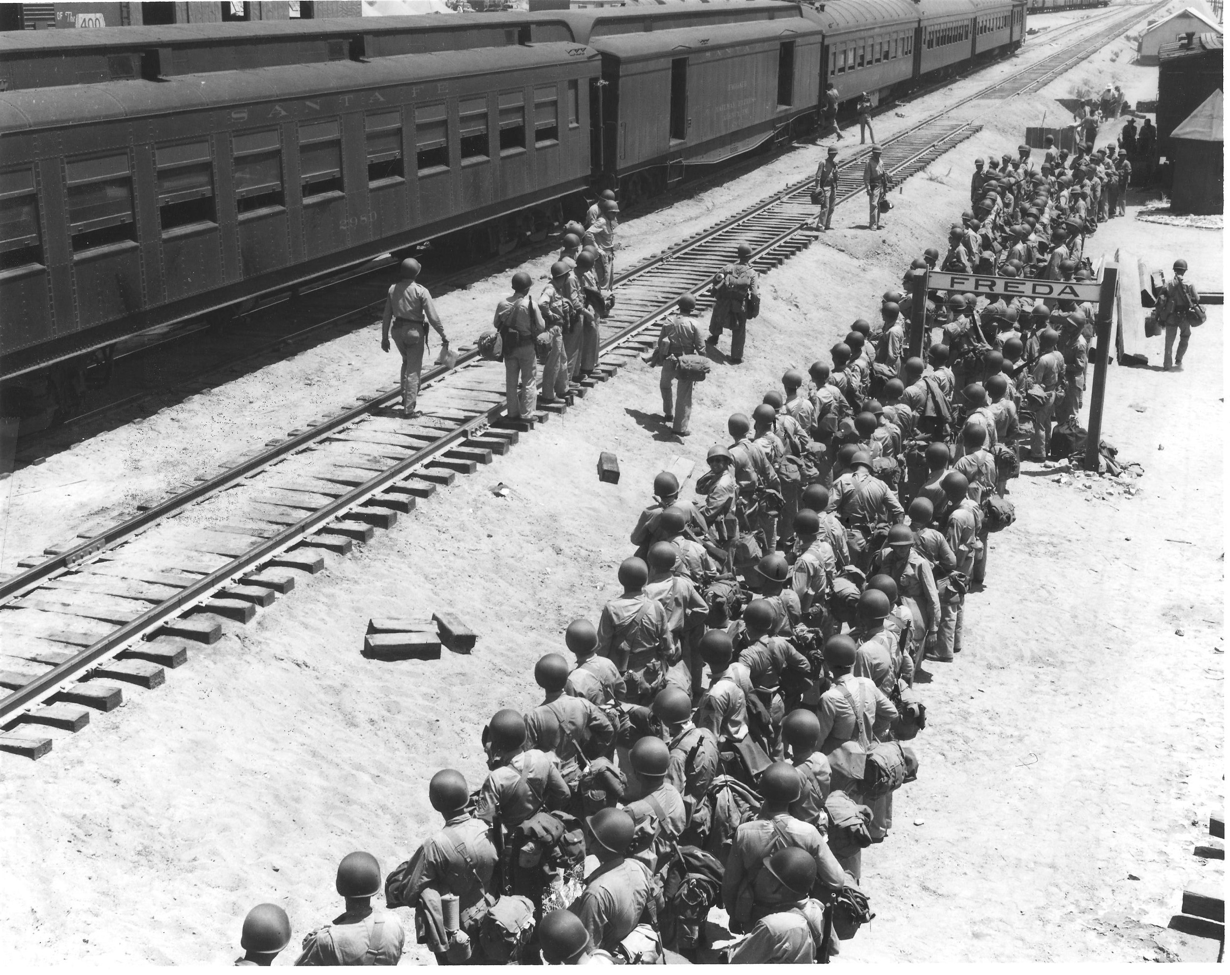 Soldiers disembark at the Freda railroad siding, off what is now Highway 62.  Established railroad lines made the Desert Training Center ideal for transporting troops and equipment. U.S. Army photograph, courtesy of the General Patton Memorial Museum.