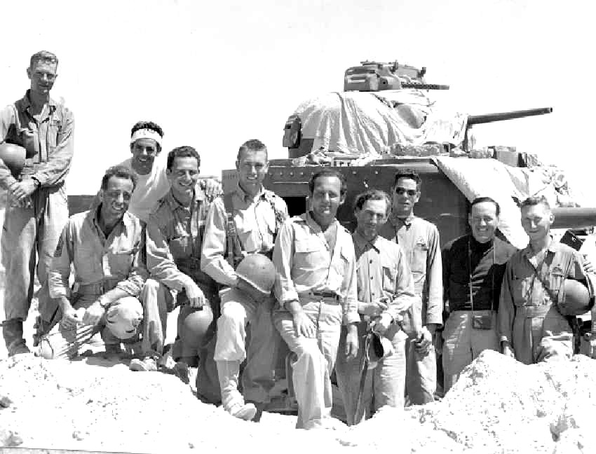 Filmed in and near the Desert Training Center, Sahara not only featured Humphrey Bogart (kneeling at left) but also members of the Fourth Armored Division who trained at the DTC. Courtesy of Eve's Magazine and Kenneth Koyen