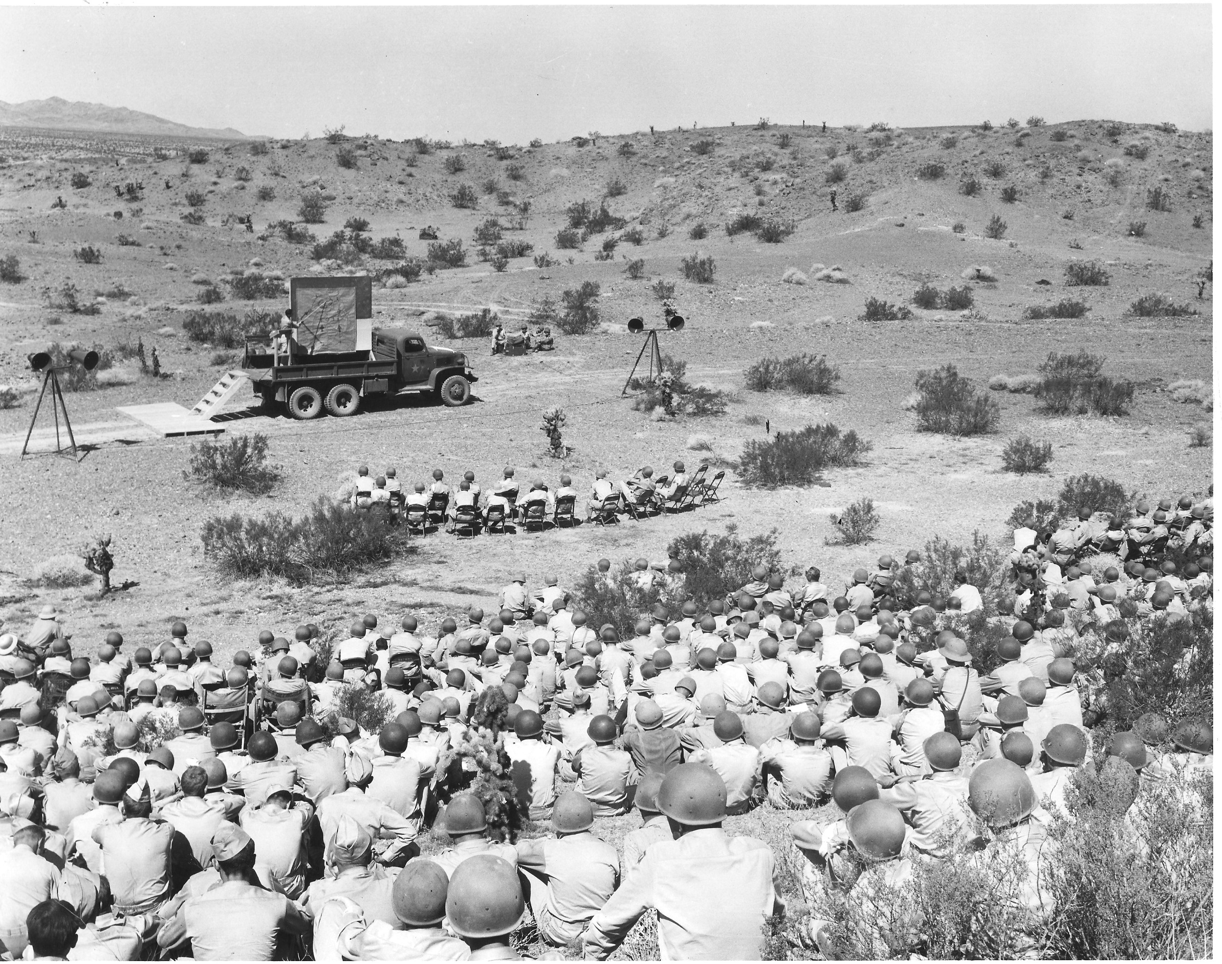 Officers listen to reviews of a maneuver held five miles from Needles, California at the Desert Training Center in September 1942. U.S. Army photograph, courtesy of the General Patton Memorial Museum.