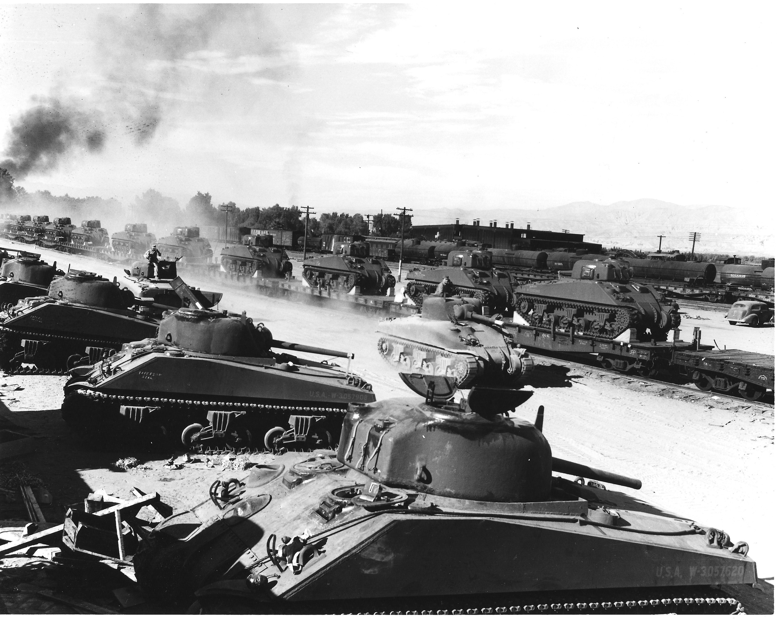 Tanks are unloaded at the Indio rail yards in December 1942. The army's use of the railroad disrupted both passenger and cargo transport; local rail yards experienced labor shortages throughout the war as keeping up with army supplies, equipment, and men seemed a never ending challenge. U.S. Army photography, courtesy of the General Patton Memorial Museum.