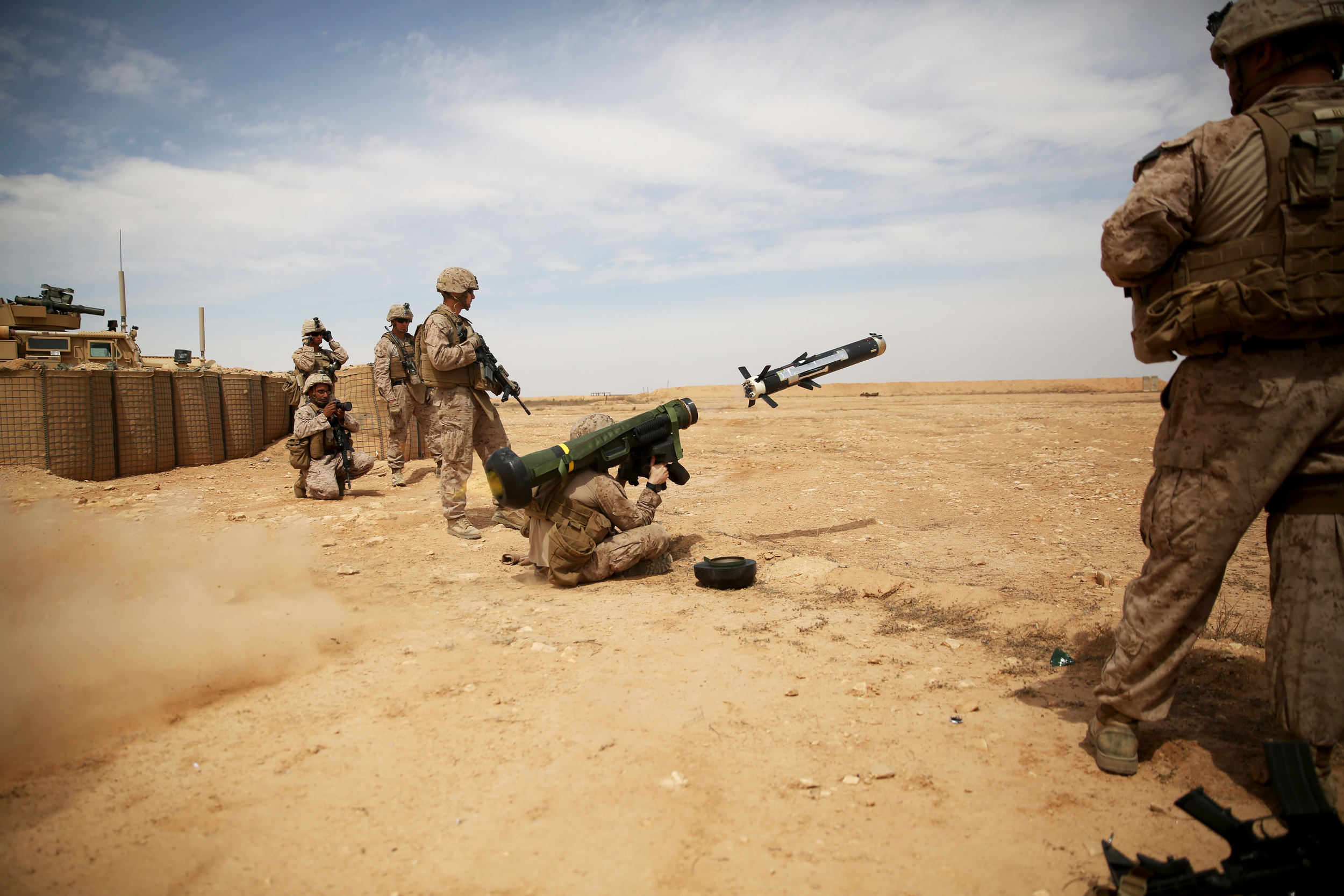 A Marine fires a FGM-148 Javelin missile at simulated enemy armored targets during a combined-arms training exercise at Al Asad Air Base, Iraq, April 3, 2015. | Photo by Cpl. Carson Gramley, United States Marine Corps.