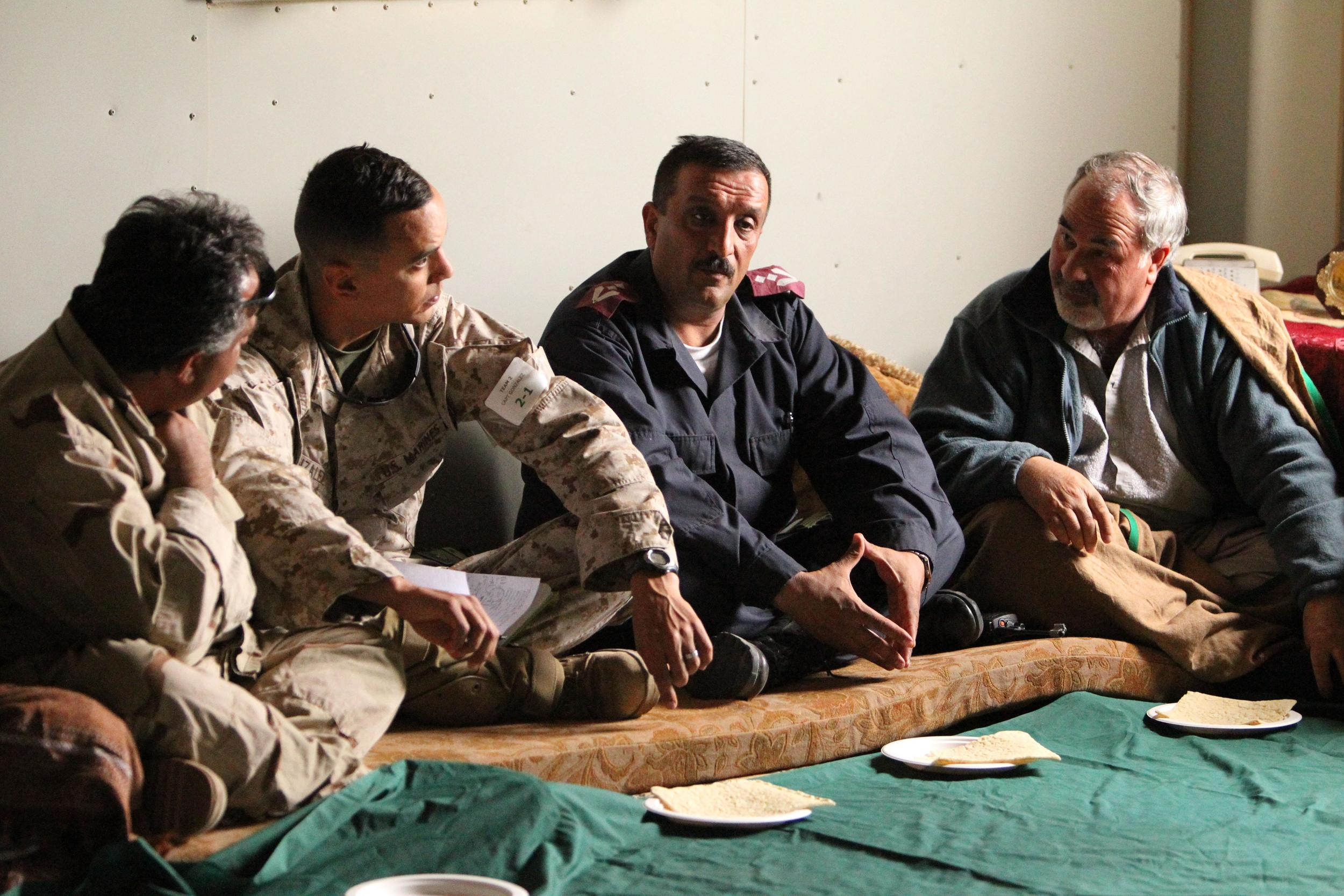 Marines and role players playing Afghani army, police, and village elders, talk during an exercise during an Advisor Training Course at Twentynine Palms. Photo by Lance Cpl. Andrew Thorburn, United States Marine Corps.