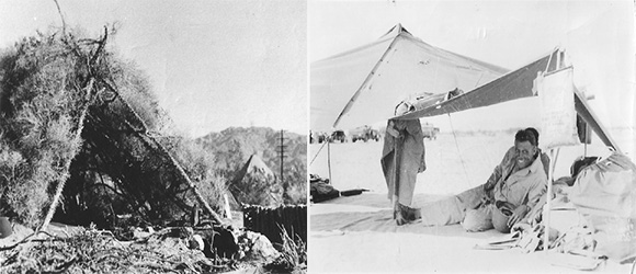 "While the divisional camps held larger canvas tents that slept multiple men and had some of the comforts of home (though no electricity or running water), troops spent much of their time in the field and thus in makeshift dwellings. To the left is a ""maneuver home"" constructed of ocotillo branches and brush. To the right, a soldier rests under a rudimentary tent. Note the bag of water hanging from the right side of the structure; it likely had to serve all of his drinking and bathing needs for the day. Some recalled using gasoline to try to prevent scorpions and snakes from crossing into their tents, but gas was scarce, especially while in the field. Courtesy of the General Patton Memorial Museum."