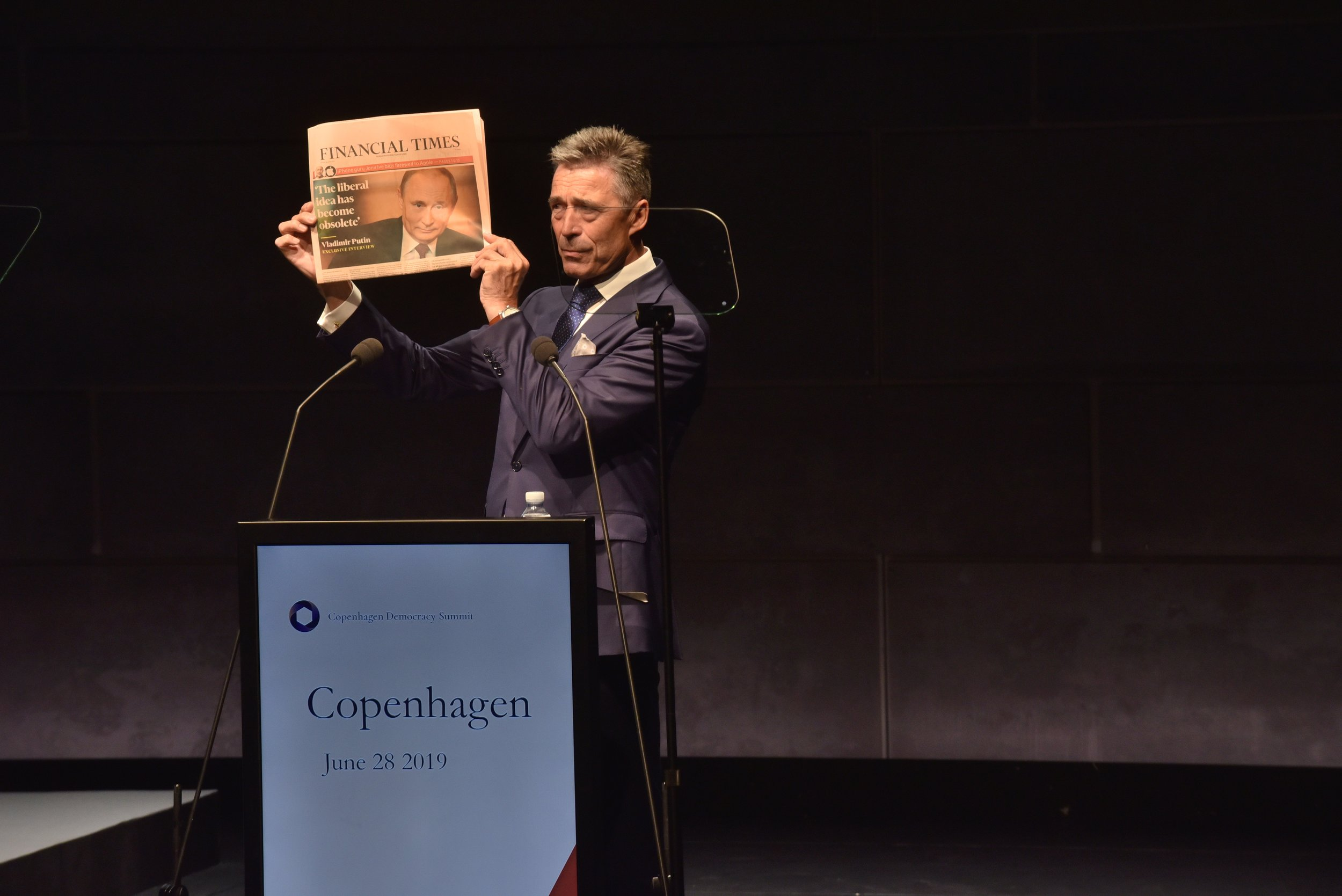 Anders Fogh Rasmussen  holding the  Financial Times , with photo of Vladimir Putin and headline 'The liberal idea has become obsolete'  (Photo courtesy AoD)