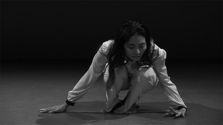 Photo of Mana dancing in white costume