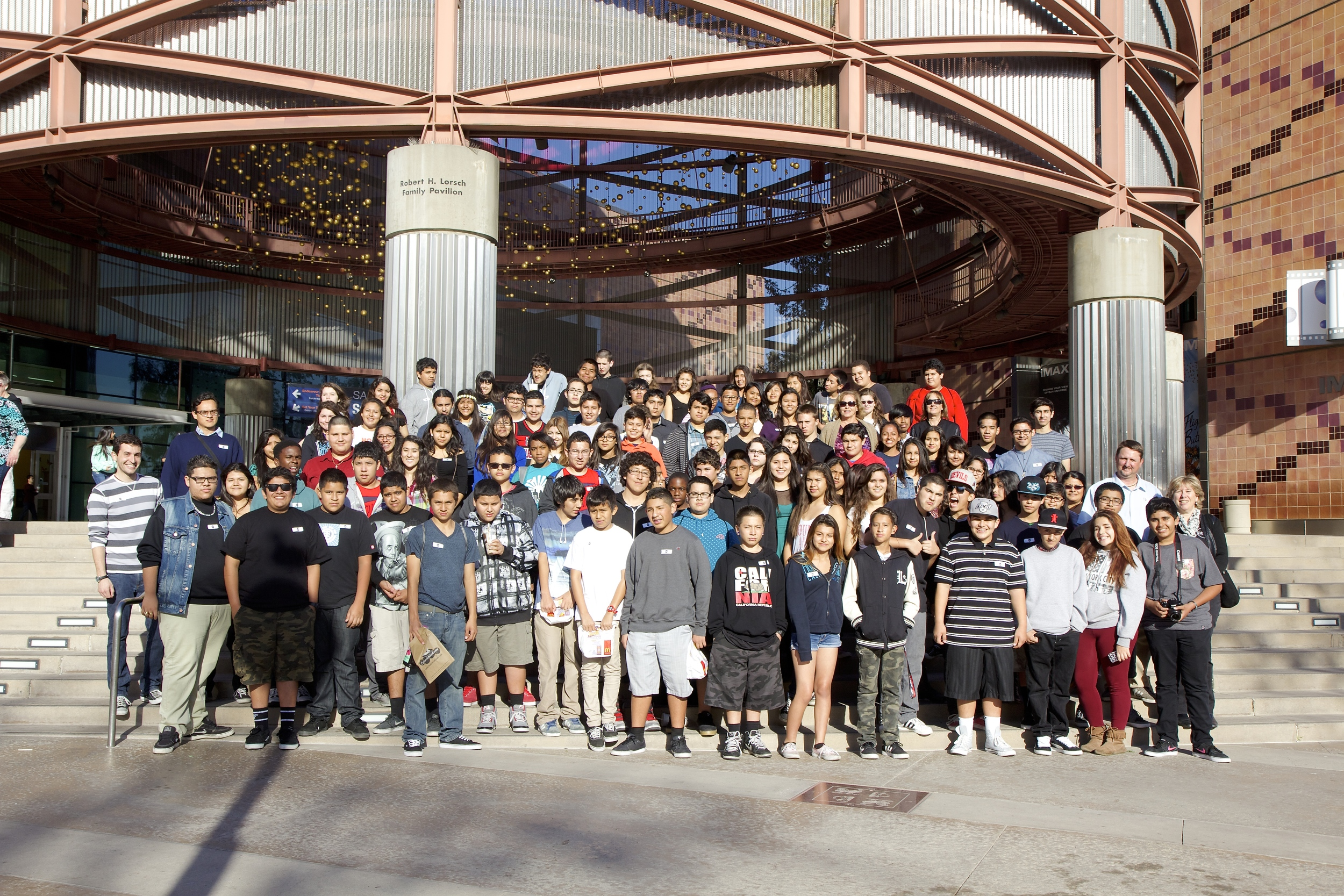Students pose for a group photo in front of the Science Center before heading home