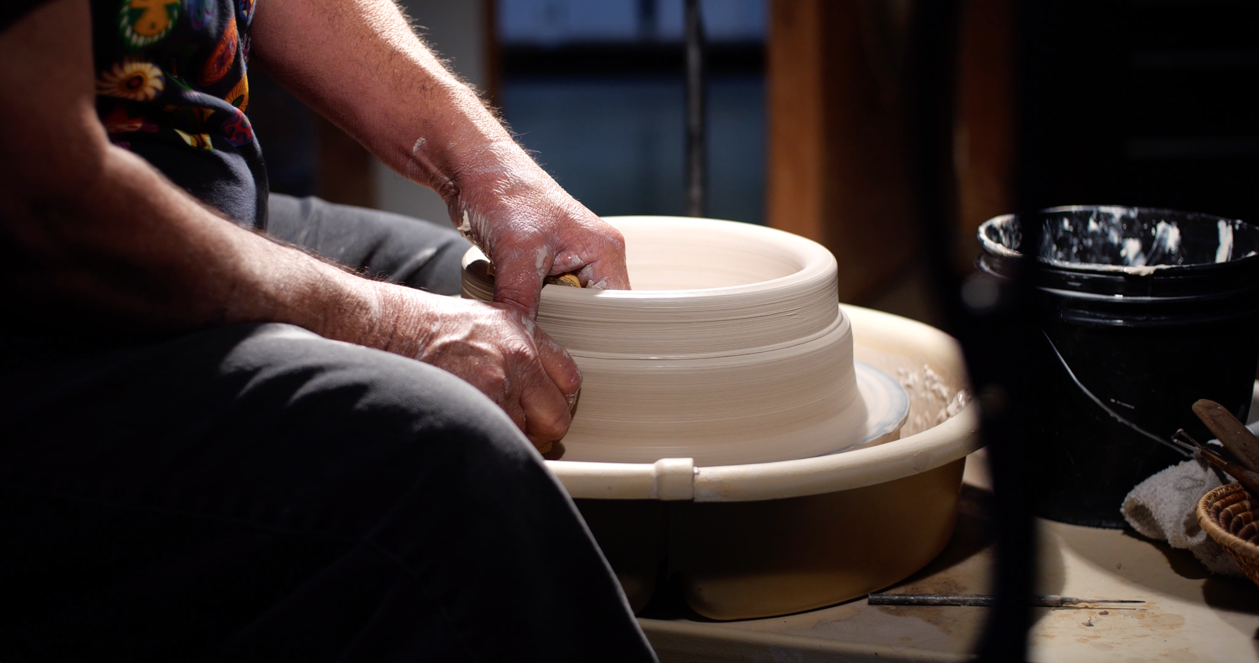 Rich Lopez shaping a pot.