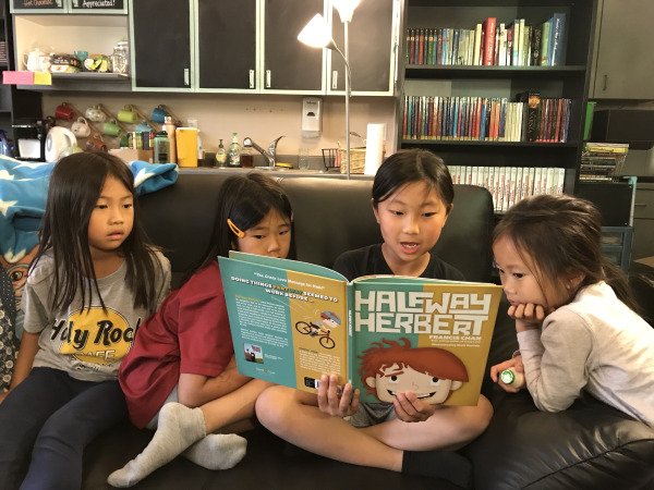 Enjoying Halfway Herbert in Bibliopolis. Books range from picture books for elementary school kids to chapter books for older students.