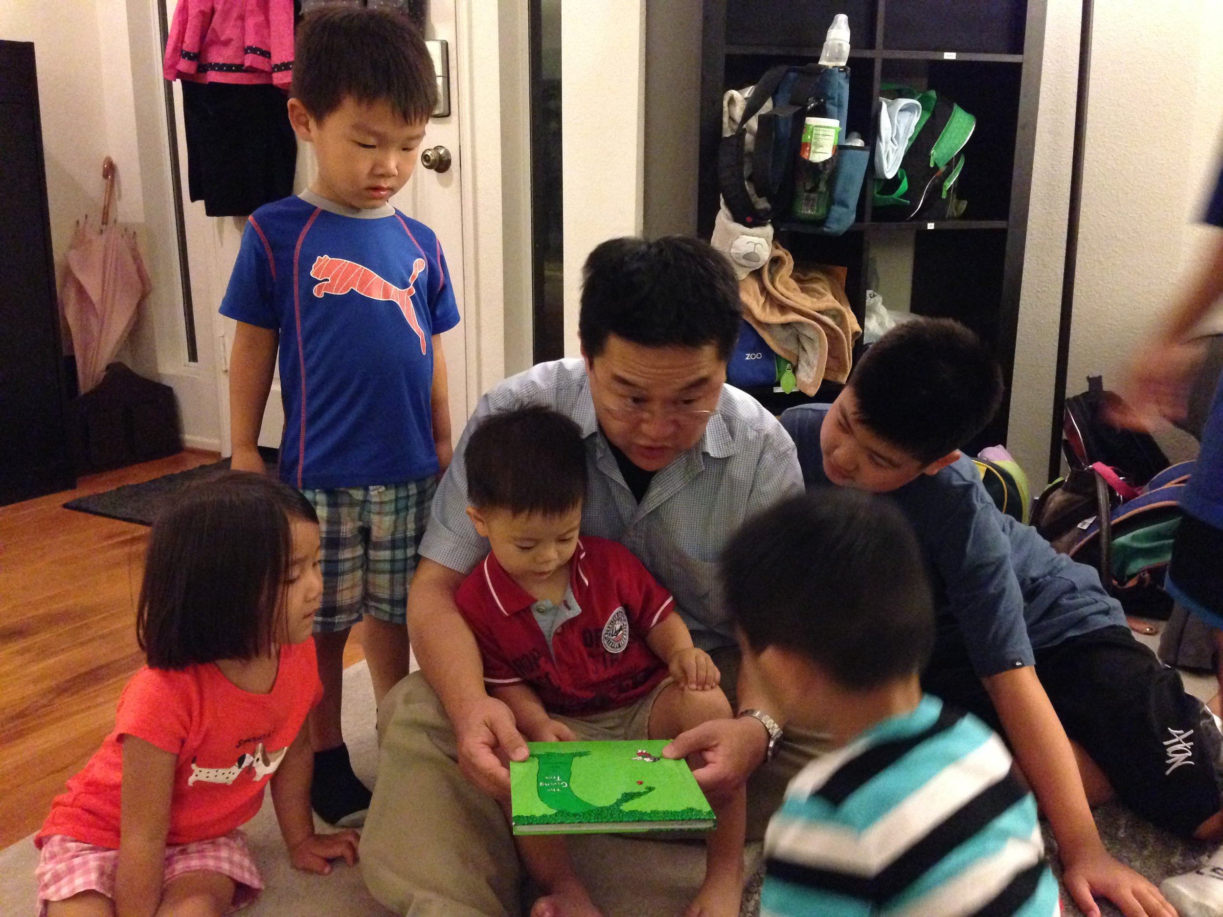Pastor Ed stealing a reading moment with some kids while visiting Gracepoint Riverside.