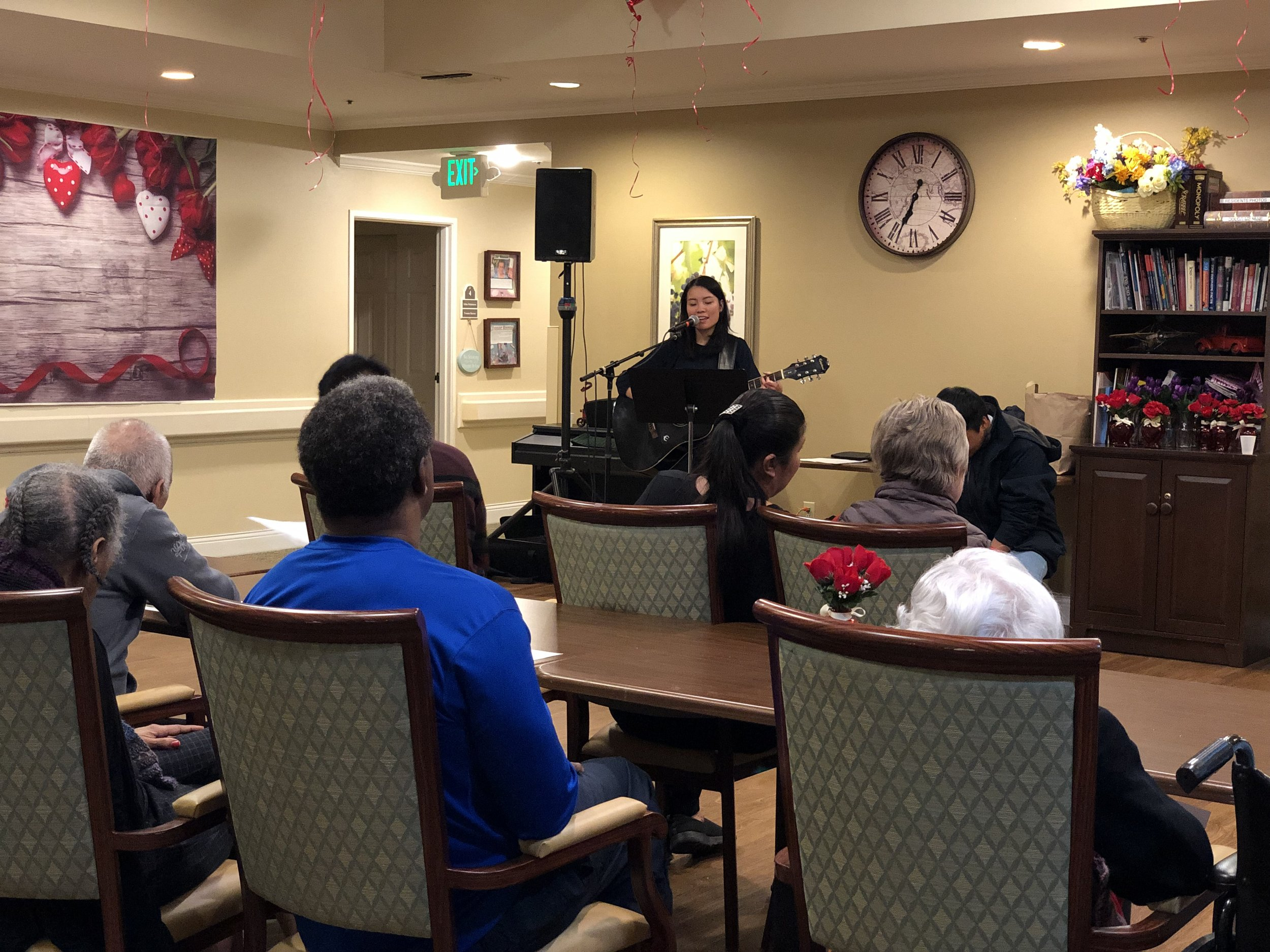 Jana Fernandez leads praise time during her group's visit to a convalescent home in Oakland.