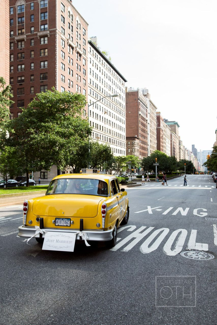 Phillipa & Clint ride away in their vintage taxi car! Photo by Christian Oth Studios.