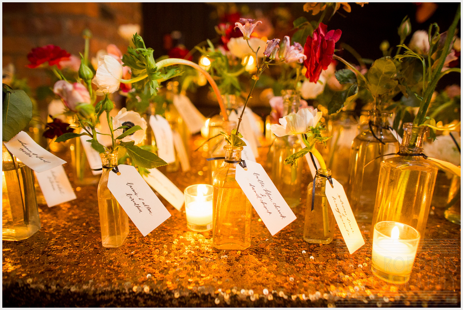 Floral arrangements were created by  Nicolette Camille