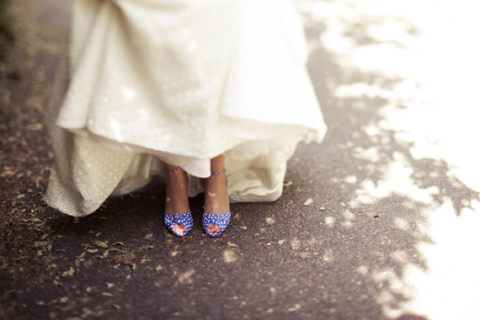 These polka dot shoes give this bridal style a great pop of color! Photo by Levi Stolove Wedding Photography