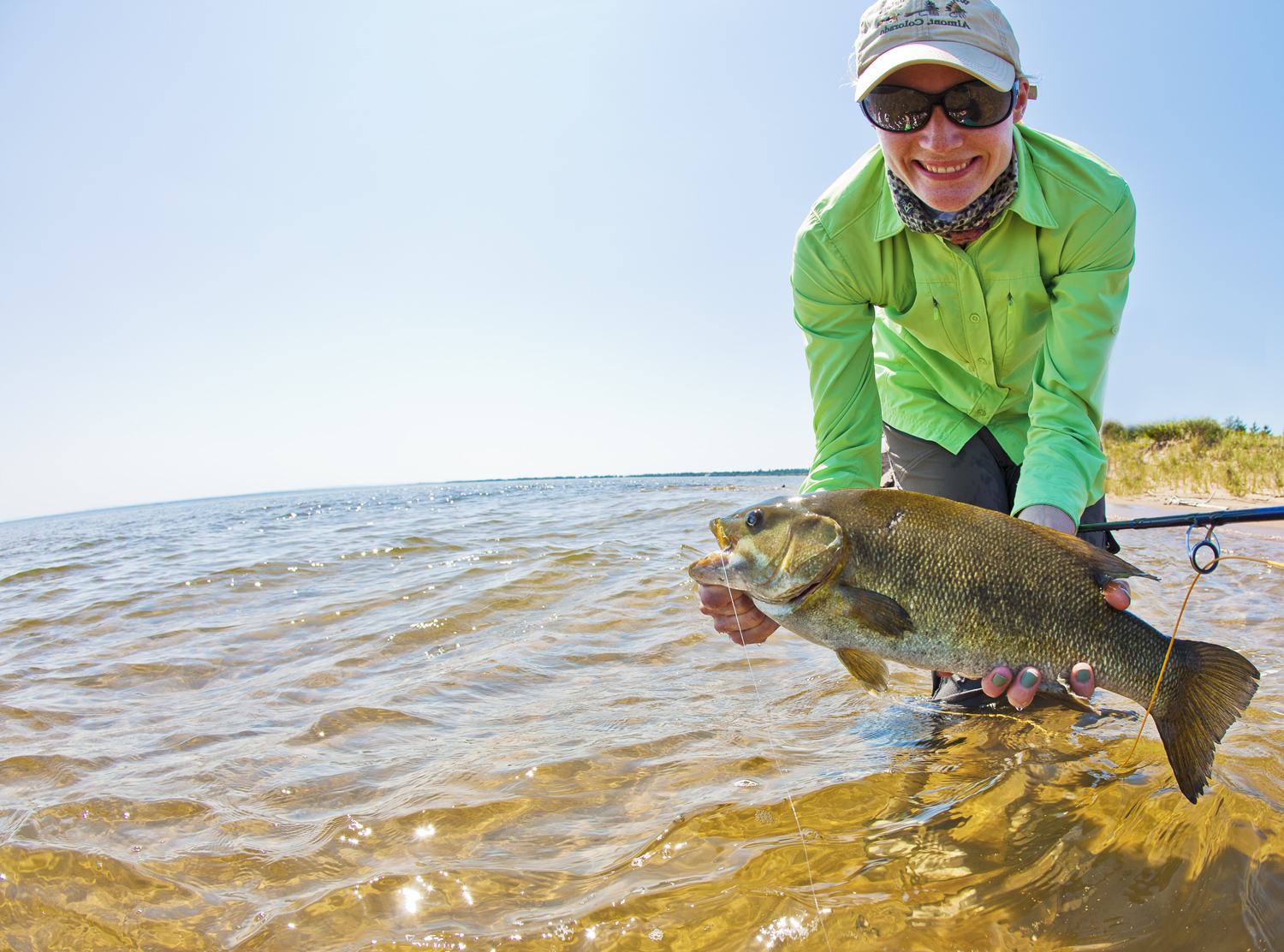 Laura with a nice sight-fished smallie out off the beach.