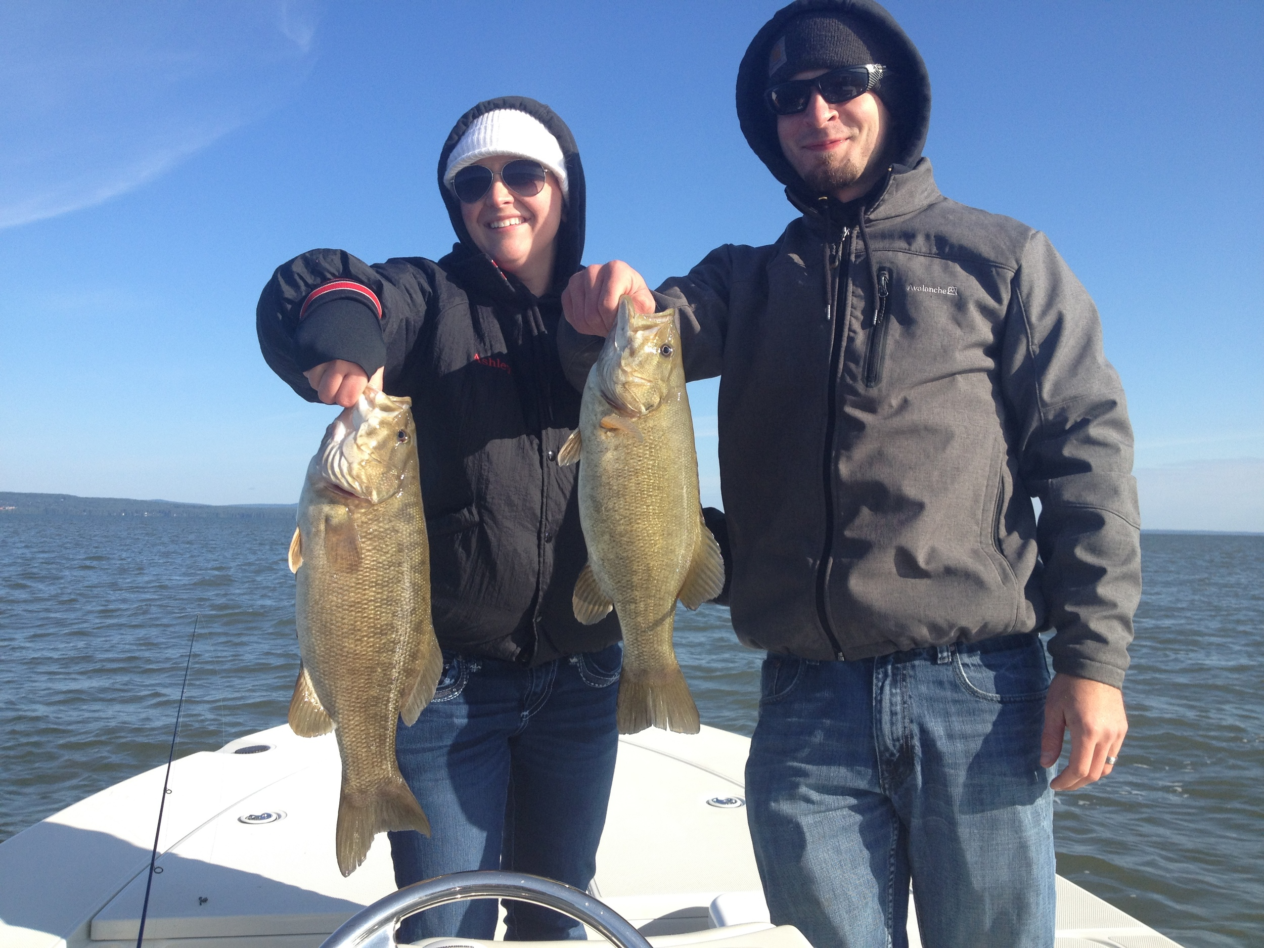 The happy young couple with a couple of hefty early fall smallmouth.
