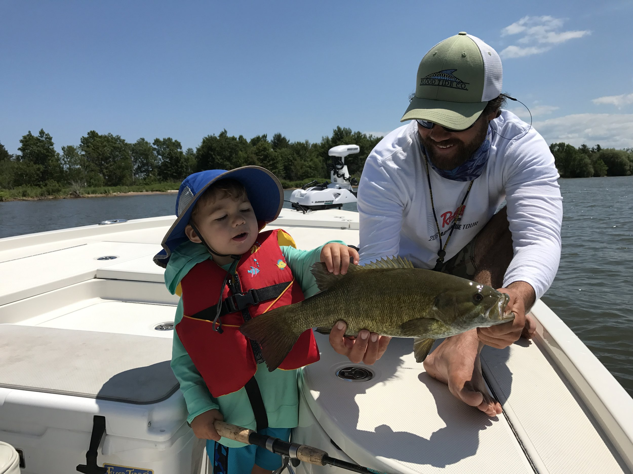 Capt. Luke and his son Jay with a Bay smallmouth