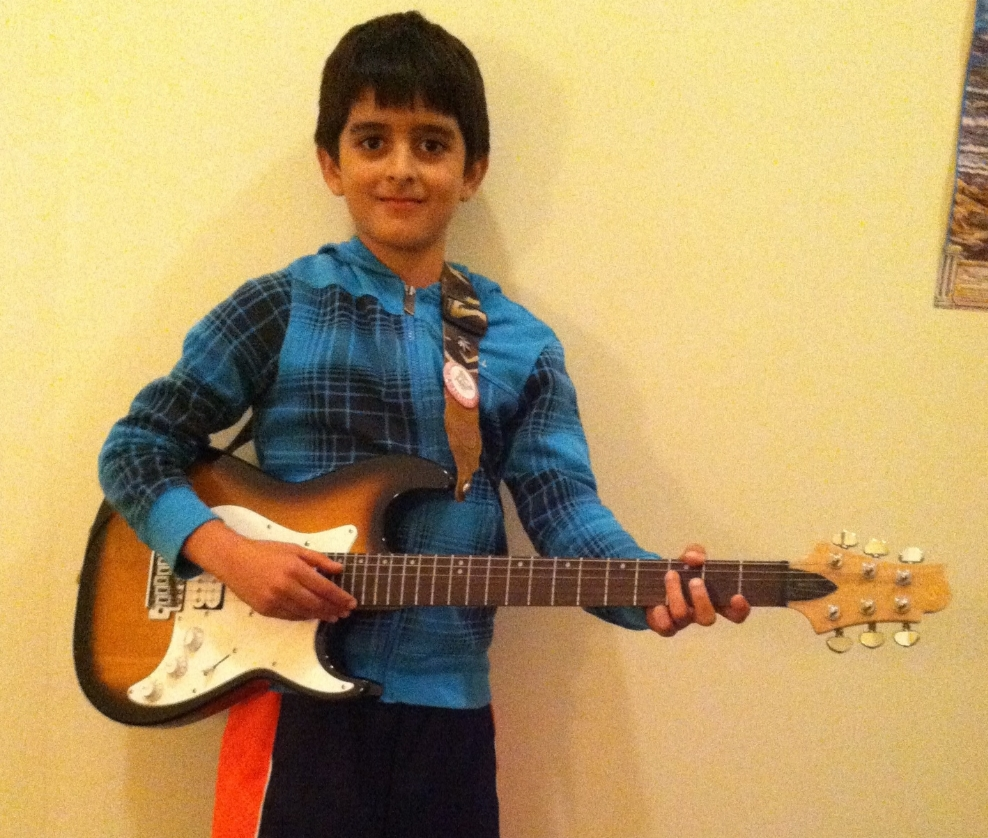 Sid Guitar student.JPG