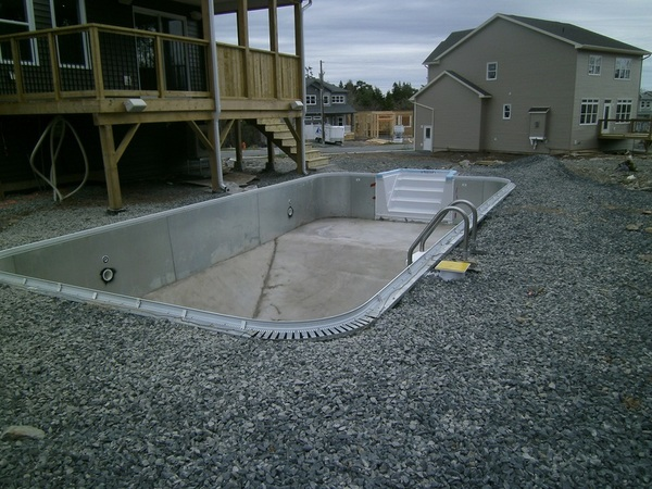 Hybrid Pools with steel panel walls, fiberglass steps and concrete floors are perfect ecoFinish substrates!