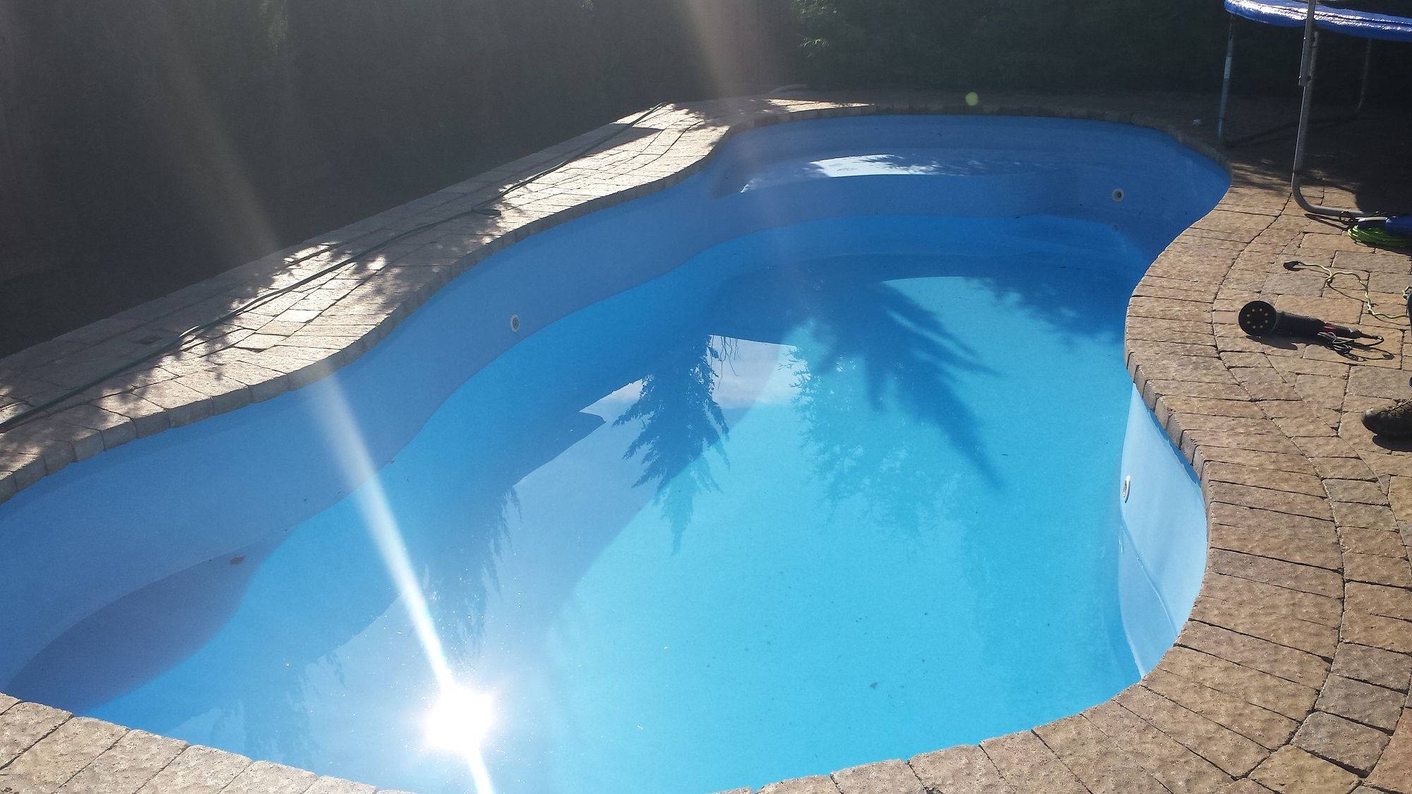 Finished glowing example of newly restored fiberglass pool