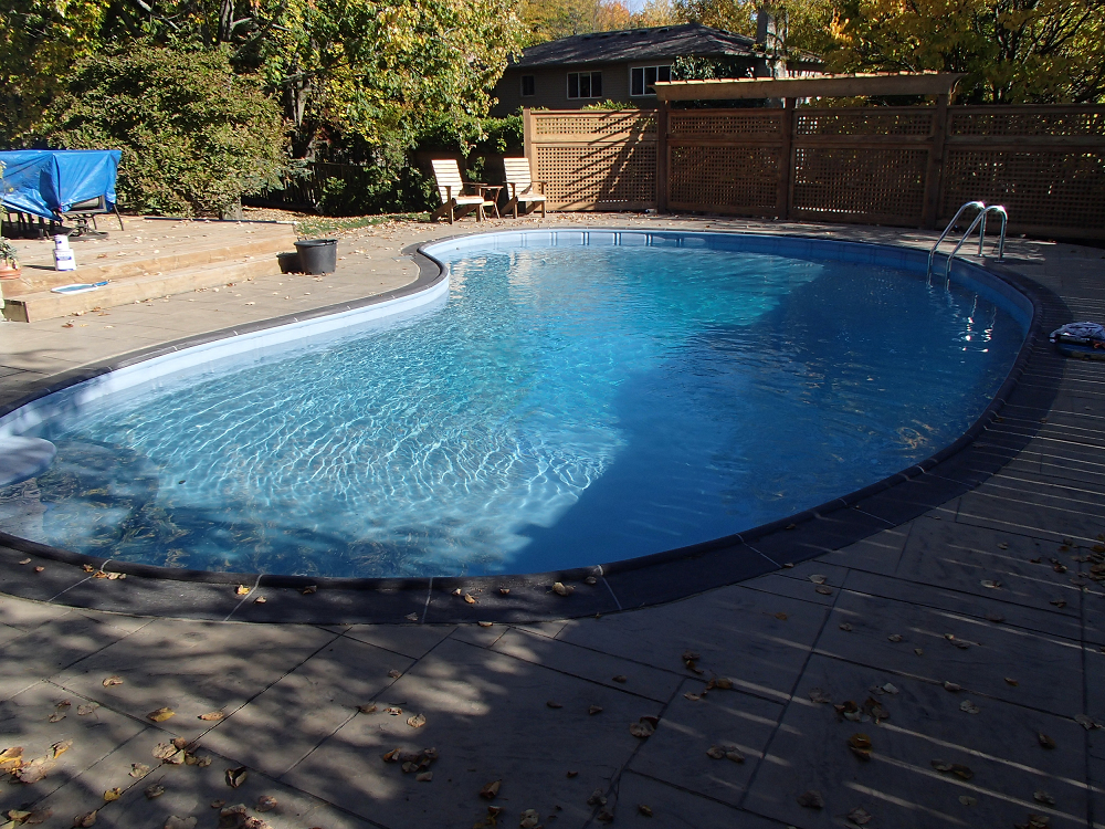 this fiberglass pool was old and tired and was transformed with aquabright.