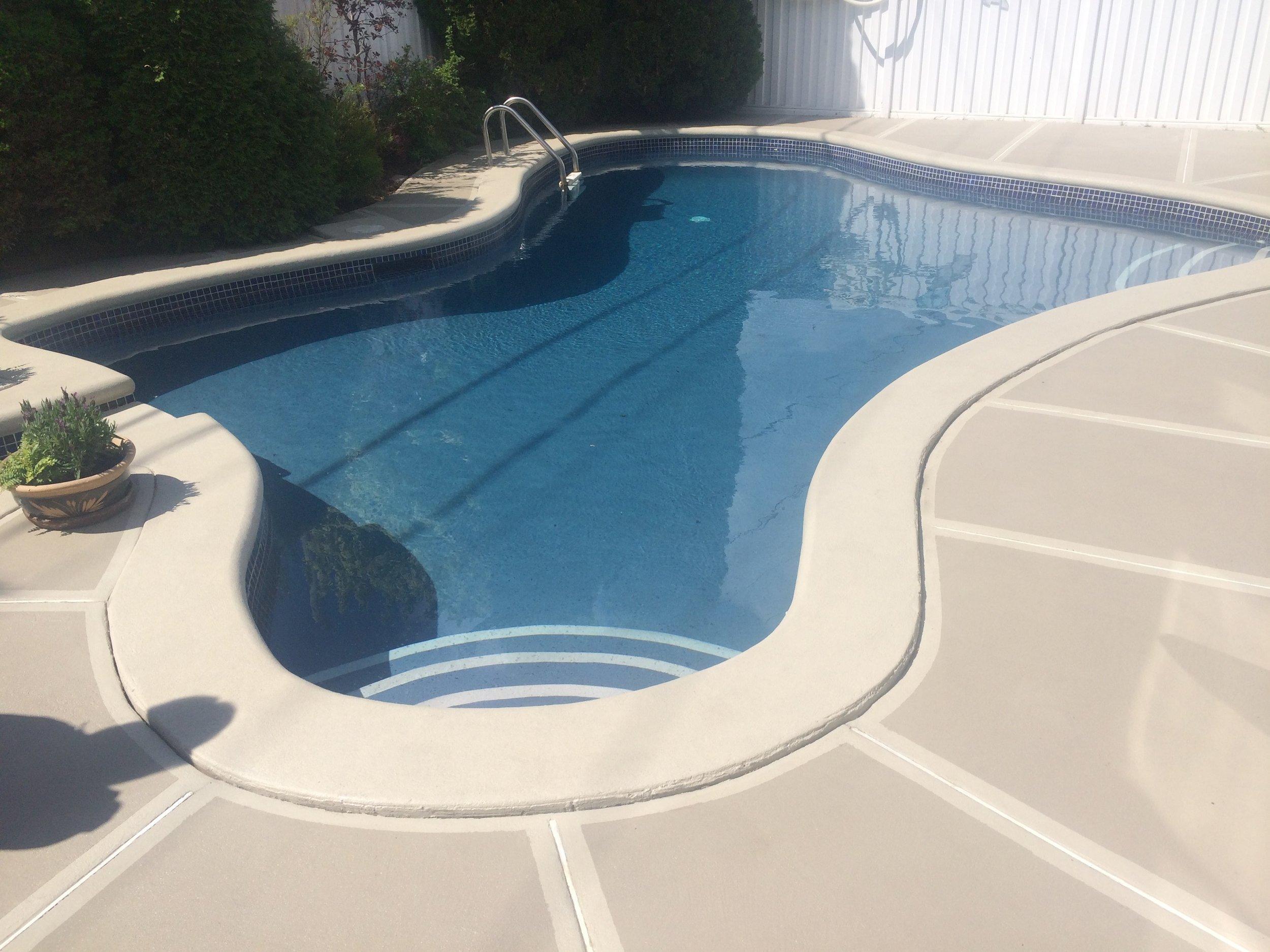 poseidon pool with light accent steps.jpg