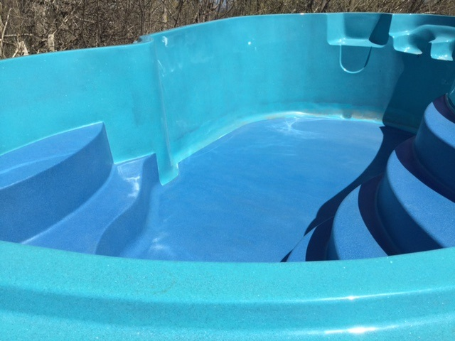 first stage of this fiberglass pool shell refinished (bottom only) sides to be finished