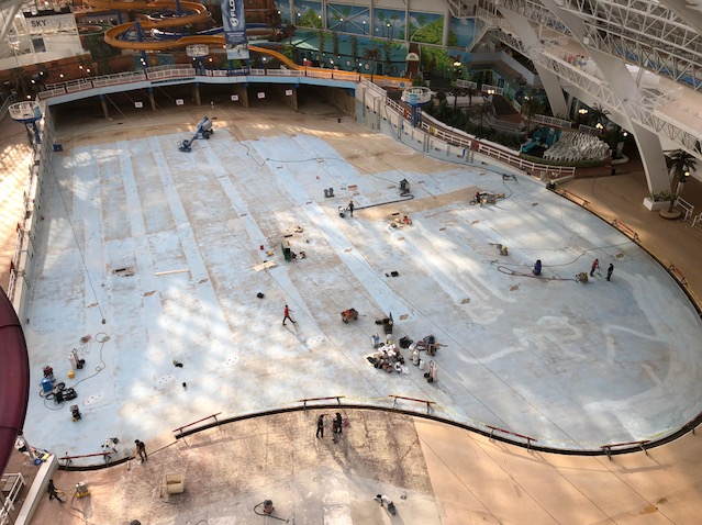 Jac Inc's team sanding the surface of West Edmonton Mall swimming pool substrate
