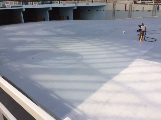 Darren Borland from Ontario Pool Coatings performs the nonslip ecoFinish coating installation
