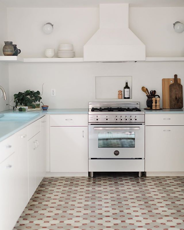 Our favorite projects pose tall orders. Mundane vision rarely makes for magic, so we love these challenges. This client wanted an aesthetic blending Americana, the 1970s, and North African architecture. The result: blue cast cement counters and sink, custom acrylic hardware, centuries old  salvaged cement tiles, vintage French factory lights, and plaster everywhere.