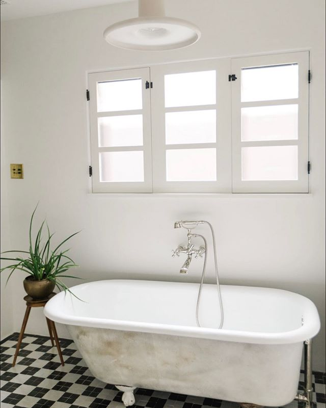 The blending of 1920s charm, 1970s clean lines and North African earthiness was a fun challenge. We chose to keep the original patina on the exterior of the vintage cast iron tub rather than re-glazing. As we design, we attempt to maintain true character rather than faux and value the storied elements in order to maintain a unique look for each project.